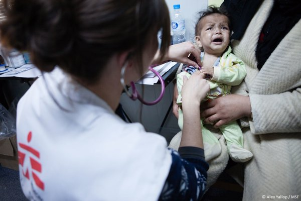 Doctors Without Borders medical team treats kids made sick by their poor living conditions in the camp. (Photo: MSF).