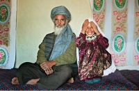 Family and friends gather for the engagement of Said Mohammed, 55, and Roshan Kasem, 8, at her home in a rural village of Ghor province. Father of the bride, Abdul Kasem, 60, said he is unhappy giving his daughter away at such a young age, but has no choice due to severe poverty. It is hard to say exactly how many young marriages take place, but according to the women's ministry and women's NGOs, approximately 57 percent of Afghan girls get married before the legal age of 16. In addition, once the girl's father has agreed to the engagement, she is pulled out of school immediately. Early pregnancies also result in an increase in complications during child birth.
