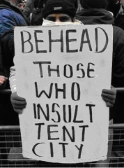 Tent city squatter threatens those who disapprove. (Photo: Breaking the Code).