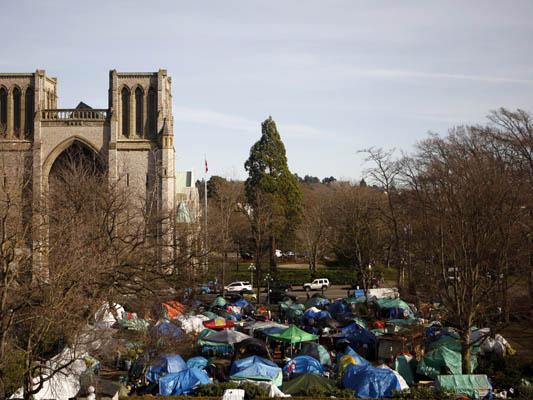 A view of the Christ Cathedral Church overlooking tent city before the block party at the camp in Victoria, B.C., Thursday, February 25, 2016. Supporters came over from Vancouver and Abbotsford during the planned soft eviction day to lend their support. THE CANADIAN PRESS/Chad Hipolito