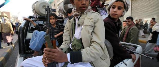Child soldiers with Houthi fighters hold weapons during a demonstration in Sanaa on March 13, 2015. © 2015 Reuters