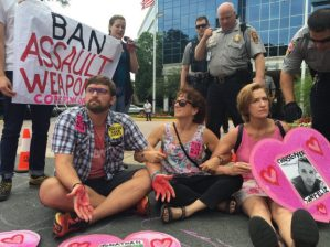 Brendan Orsingeron, Codepink protest at the NRA office, Fairfax, Virginia June 19, 2016. (Photo: CODEPINK).