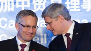 nternational Trade Minister Ed Fast, left, announced today he will be leading a six-day trade mission to China in May. He is seen here speaking with Prime Minister Stephen Harper during a ceremony in Beijing on Feb. 9, 2012. (Adrian Wyld/Canadian Press)