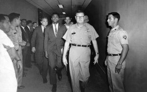 Muhammad Ali was escorted from the armed forces examining station in Houston after refusing to be inducted into the Army on April 28, 1967. Credit Associated Press