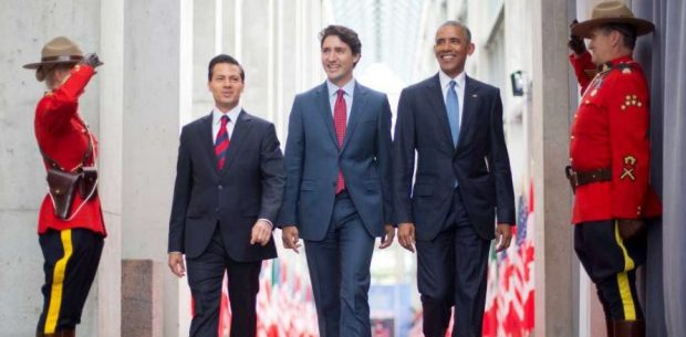 President Barack Obama walks with Canadian Prime Minister Justin Trudeau and Mexican President Enrique Pena Neito at the National Gallery of Canada in Ottawa, Canada, Wednesday, June.