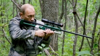 Vladimir Putin uses a tranquilizer gun to sedate an Amur Tiger during his visit to a nature reserve.