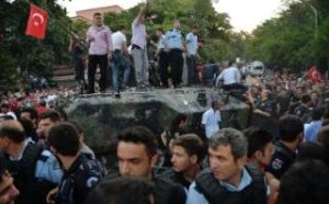 People gather and some stand atop of a Turkish army, armoured vehicle  CREDIT: STP