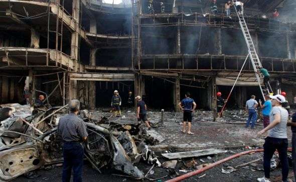 Tthe aftermath of the large explosion that hit Baghdad's central Karrada district.