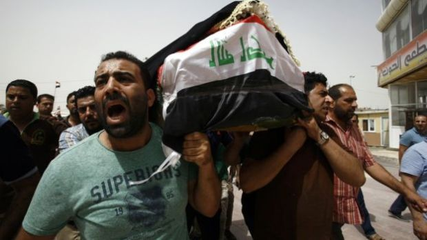 Iraqi men carry a coffin in the holy Iraqi city of Najaf on July 3, 2016. (Photo: copyright GETTY IMAGES).