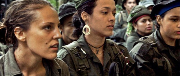 "Alice Speri, left, a host on ""Woman,"" with rebel soldiers in Colombia. (Photo: Arianna LaPenne/ Viceland)."
