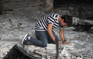 An Iraqi man reacts on July 4, 2016 as he enters a building that was destroyed in a suicide-bombing attack which took place a day earlier in Baghdad's Karrada neighbourhood.