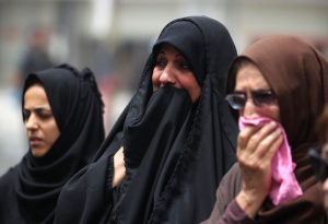 Iraqi women react on July 4, 2016 at the site of a suicide-bombing attack which took place a day earlier in Baghdad's Karrada neighbourhood . Iraqis mourned the more than 200 people killed by a jihadist-claimed suicide car bombing that was among the deadliest ever attacks in the country. The blast, which the Islamic State group said it carried out, hit the Karrada district early on July 3 as the area was packed with shoppers ahead of this week's holiday marking the end of the Muslim fasting month of Ramadan. / AFP PHOTO / AHMAD AL-RUBAYE