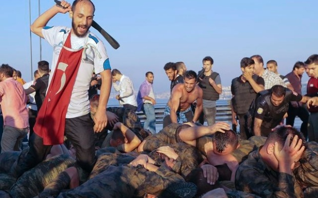 Surrendered Turkish soldiers who were involved in the coup are beaten by a civilian on Bosphorus bridge in Istanbul, Turkey, July 16, 2016. Reuters