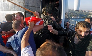 Soldiers push each other to board a bus to escape the mob after troops involved in the coup surrendered on the Bosphorus Bridge in Istanbul, Turkey July 16, 2016. Reuters