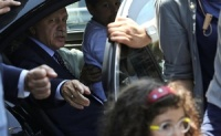 Turkish President Tayyip Erdogan sits inside a car with family members at Istanbul airport, Turkey, July 16, 2016. Reuters