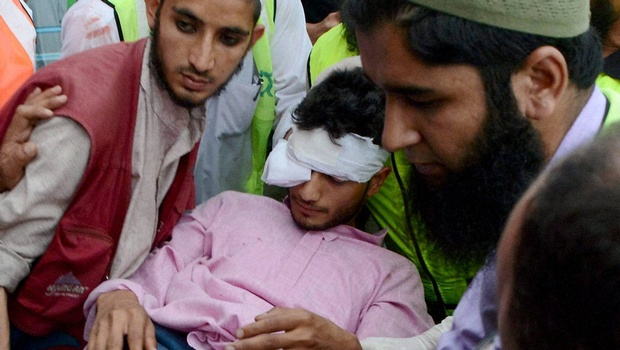 An injured civilian being shifted to SMHS hospital after clashes at Beerwah in Srinagar on Friday. Two more protesters were killed and dozens injured in fresh firing during clashes in valley. (Photo PTI).