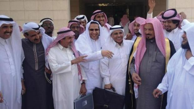 Saudi human rights activists gather outside the Criminal Court of Riyadh following a hearing in the trial of fellow activists Abdullah al-Hamid and Mohammed al-Qahtani. Sulaiman al-Rashoodi (second from right), Mohammed al-Qahtani (third from right), Waleed Abu al-Khair (center, fourth from right) and Abdullah al-Hamid (fifth from right) © 2013 Private