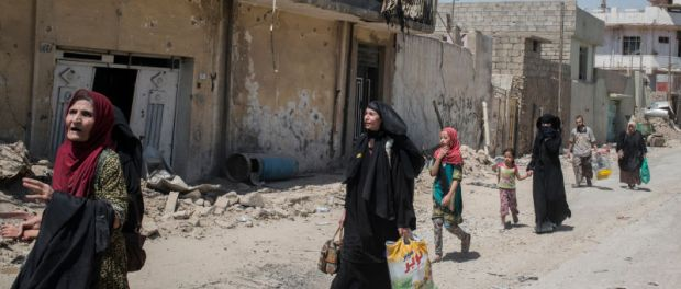 Iraqi civilians flee the Islamic State controlled Old City of west Mosul on June 23, 2017. Image via Getty.